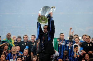 Inter manager Jose Mourinho lifts the Champions League trophy