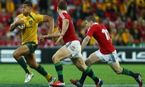 The Australia winger Israel Folau, left, outwits his Lions pursuers with a searing run