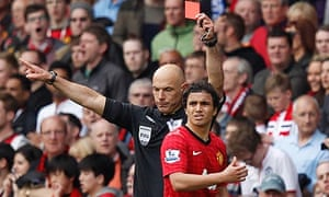 Manchester United's Rafael Da Silva is shown a red card by referee Howard Webb
