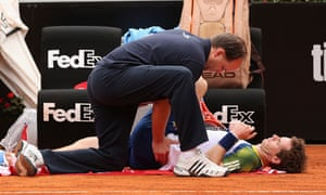 Andy Murray receiving assistance during his second-round match at the 2013 Italian Open