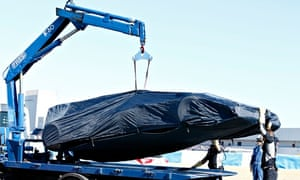 Daniel Ricciardo's Red Bull car is removed from the Jerez circuit after it stopped during F1 testing