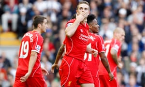 Liverpool's Jordan Henderson celebrates scoring his side's second goal against West Brom
