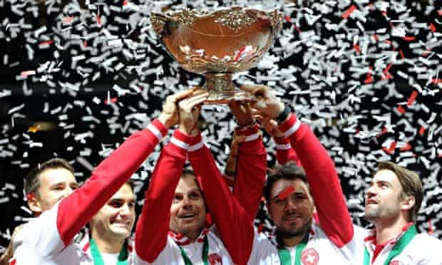 Switzerland, including Roger Federer, second from left, celebrate winning the Davis Cup