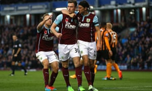 Ashley Barnes, centre, celebrates putting Burnley 1-0 up against Hull City in the Premier League