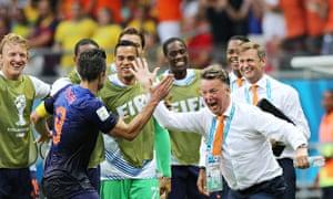 Robin van Persie celebrates with coach Louis van Gaal