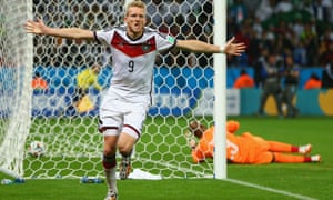 André Schürrle celebrates scoring for Germany in the second minute of extra time against Algeria in