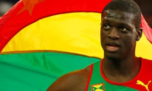 Grenada's Kirani James holds his national flag as he celebrates after winning the men's 400m at Hamp