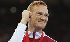 England's Greg Rutherford celebrates with his gold medal after winning the long jump on Wednesday ev