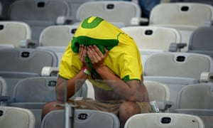 A Brazilian fan contemplates his national team's 7-1 defeat against Germany in Belo Horizonte.