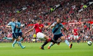 Manchester United's Robin Van Persie scores against West Ham United in the Premier League match