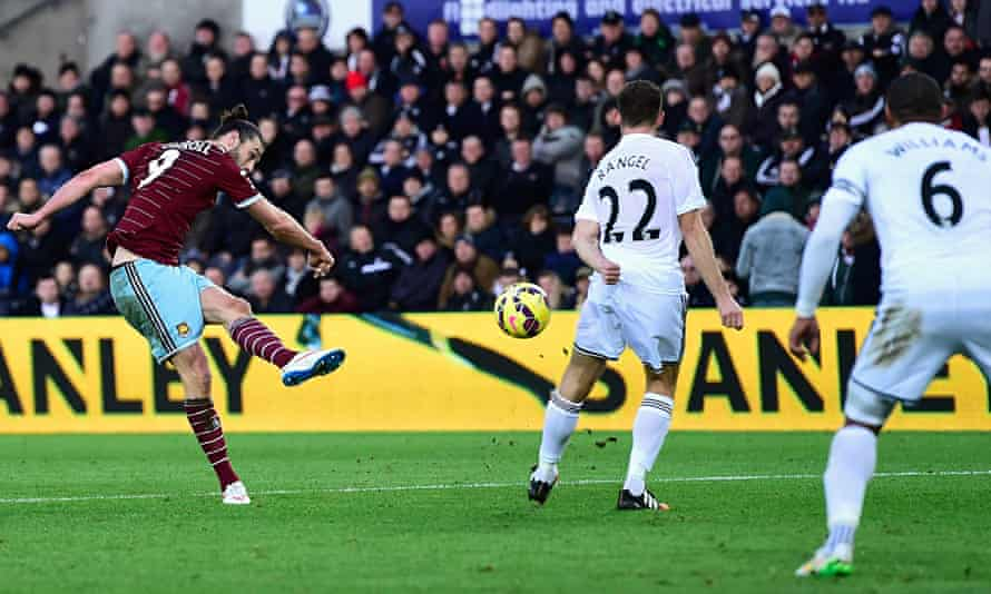 Andy Carroll scores for West Ham against Swansea City at Liberty Stadium