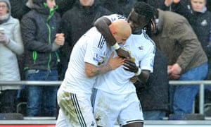 Swansea's Bafétimbi Gomis celebrates with Jonjo Shelvey against Manchester United