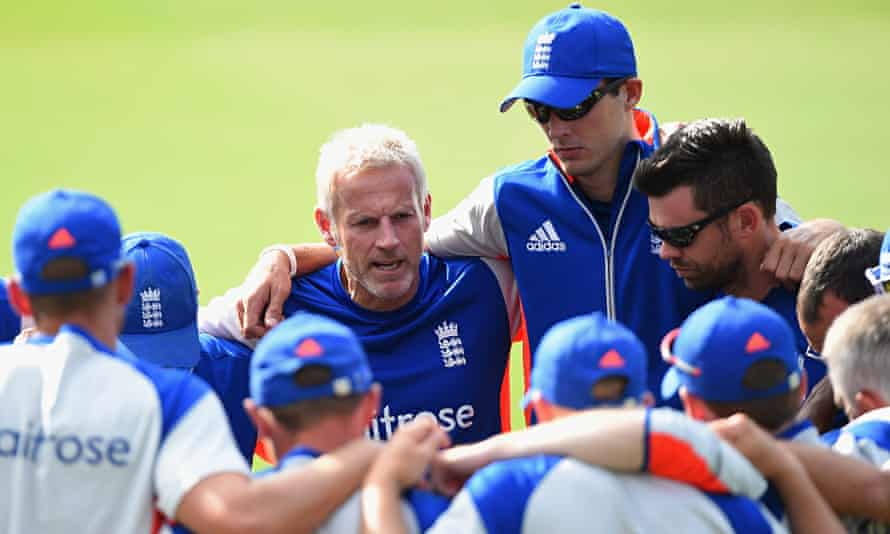 The England coach, Peter Moores, centre, gathers his players round during a nets session in Sydney