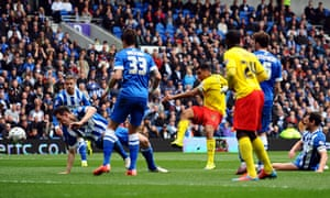 Watford's Troy Deeney scores the first goal against Brighton in the Championship match at the Amex
