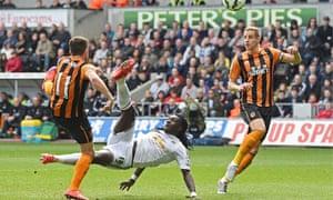 Bafétimbi Gomis scores Swansea's second goal against Hull City in the Premier League match