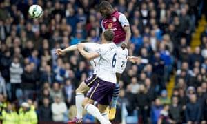 Christian Benteke scores Aston Villa's first goal against Everton in the Premier League