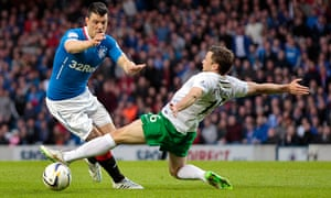 Rangers' Haris Vuckic (left) tries to evade a tackle from Hibernian's Lewis Stevenson during the Sco