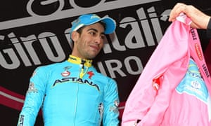 Astanta's Fabio Aru receives the overall leader's pink jersey after stage 13 of the Giro d'Italia
