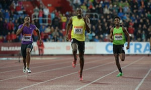 Jamaica's Usain Bolt powers ahead of Carvin Nkanata of Kenya and Isiah Young of the US in the 200m i