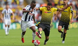 Watford's Étienne Capoue, right, in action with West Brom's Saido Berahino in the Premier League
