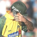 A dejected Ricky Ponting walks back to the pavilion