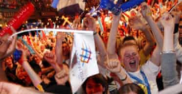 Fans in Glasgow celebrate the awarding of the 2014 Commonwealth Games
