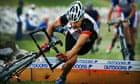 Cyclocross: Bert Hill stumbles over a barrier