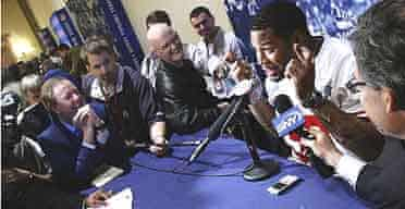 Michael Strahan on the New York Giants speaks to the press