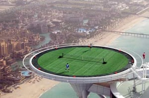Andre Agassi and Roger Federer play on the world's most unique tennis court, the Burj Al Arab hotel's helipad, Dubai