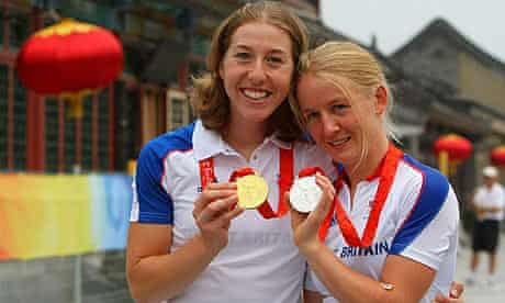Emma Pooley, right, with her silver medal, alongside road race champion Nicole Cooke