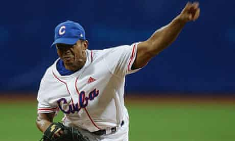 Cuba's Adiel Palma pitches during a preliminary game against Canada