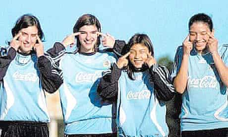 Argentina women's footballers making slit-eyed gesture