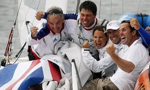 Iain Percy, second right, and Andrew Simpson, second left, celebrate with Peter Bentley, left, Bryony Shaw and Ben Ainslie