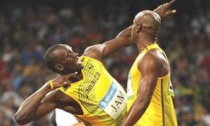 Usain Bolt and Asafa Powell celebrate
