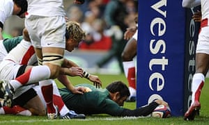 Danie Rossouw scores a try for South Africa against England.