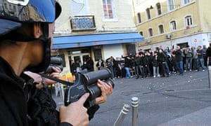 Riot police confront Paris St Germain fans in the streets of Marseille