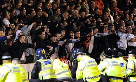 Police surround fans at the Manchester United end during the Carling Cup match at Oakwell