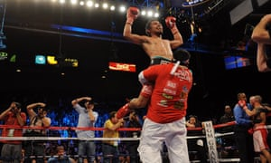 Manny Pacquiao celebrates after stopping Miguel Cotto in the 12th round