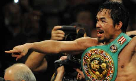 Manny Pacquiao celebrates after defeating Miguel  Cotto in their WBO welterweight fight