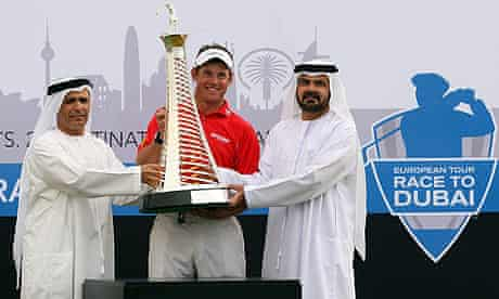 Lee Westwood is presented with the Race to Dubai Trophy