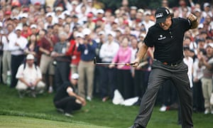 Phil Mickelson reacts after sinking a ball at the 16th in the HSBC Champions