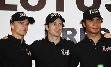 Heikki Kovalainen (left), Jarno Trulli (centre) and Fairuz Fauzy - Lotus F1