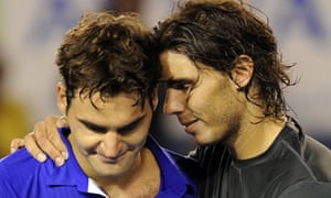 Rafael Nadal hugs his defeated opponent Roger Federer