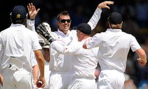 Graeme Swann celebrates the wicket of West Indies' Devon Smith