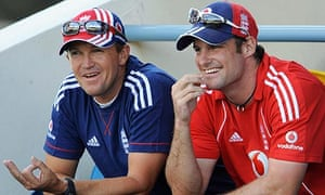 England's Andy Flower and Andrew Strauss share a joke on the balcony at the Queen's Park Oval