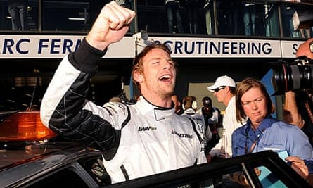 Brawn GP driver Jenson Button celebrates after taking pole in Australia