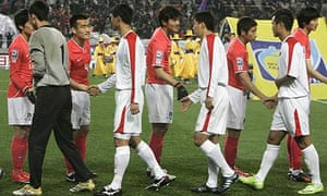 South Korean players shake hands with North Korean players
