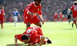 Liverpool's Robbie Fowler pretends to snort cocaine from the touch line
