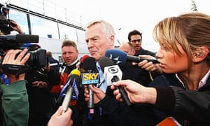FIA president Max Mosley is beseiged by the media as he arrives in the paddock at Silverstone
