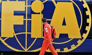 A team member of Ferrari walks in front of the FIA motorhome at Silverstone